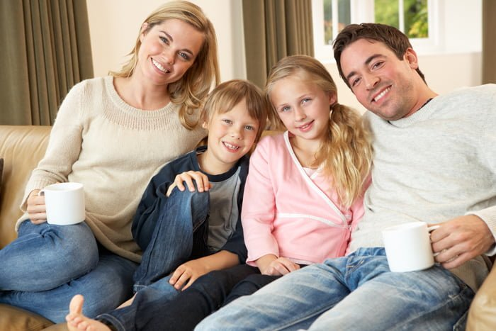 Happy-young-family-sitting-on
